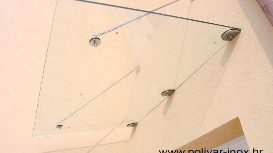 Inox tenda sa kaljenim staklom pričvršćena sajlama za fasadu